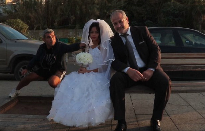 An outraged passer bye tries to get the young bride's attention during a staged photo shoot drawing attention to the issue of child marriage in Lebanon. © KAFA (enough) Violence & Exploitation, Lebanon